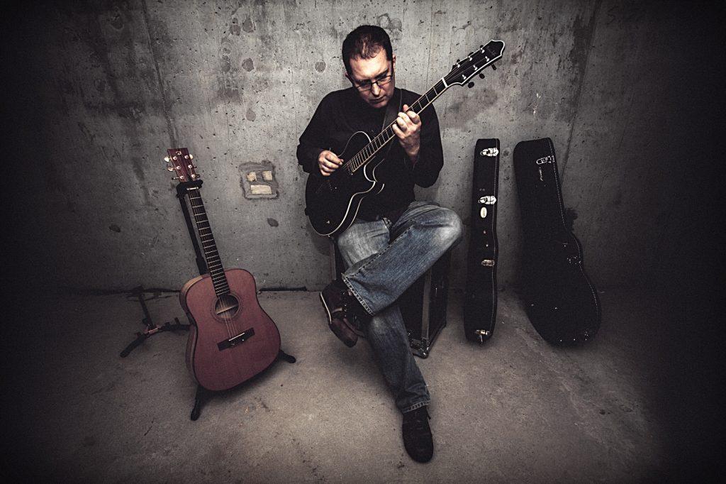 Marcin Olak. Gitarzysta.